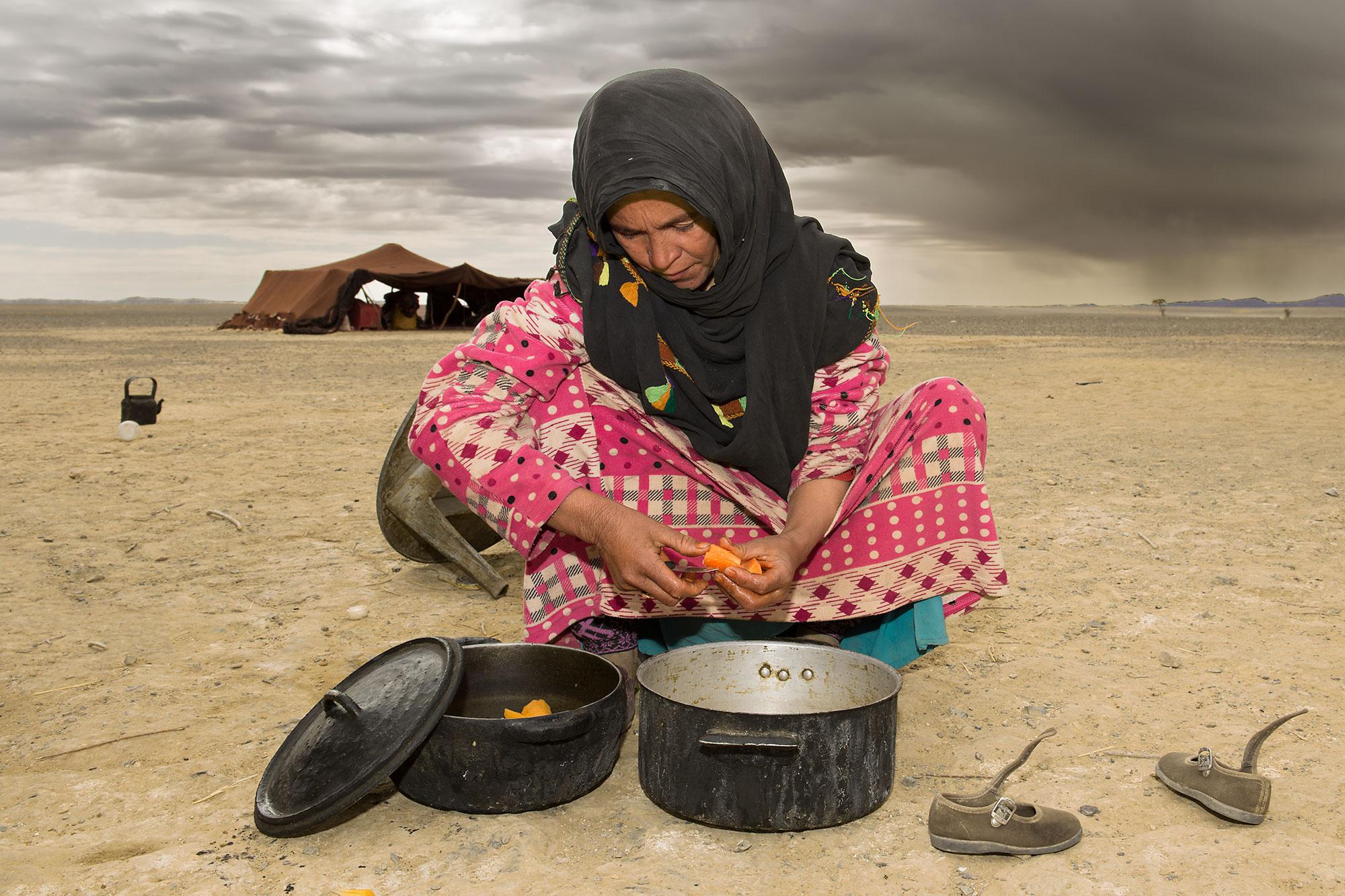 Berber Woman cooking outside Sahara Desert Morocco