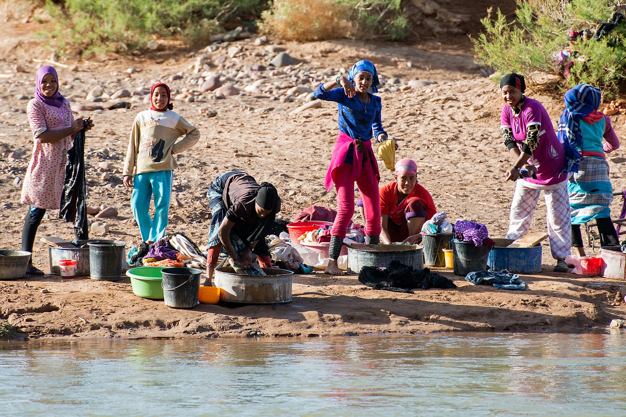 Berber Woman washing cloth in River Morocco